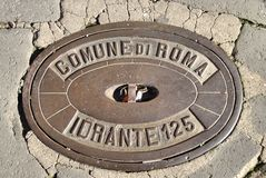 Water Hydrant Cover Plate. Comune di Roma water hydrant 125 cover royalty free stock photos