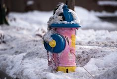 Water hydrant. Painted Water hydrant covered in snow Stock Image