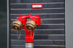 Water hydrant. On a wall Royalty Free Stock Image