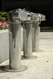 Water hydrants. Three water hydrants downtown Stock Photo