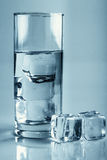 Water with ice cubes glass studio shot Royalty Free Stock Photos