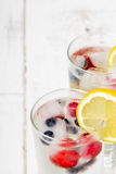 Water with  ice cubes - a refreshing drink Stock Images
