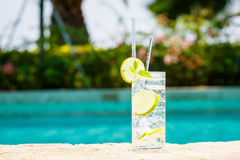 Water with ice at the edge of a resort pool. Concept of luxury v Royalty Free Stock Images