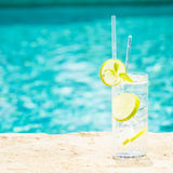 Water with ice at the edge of a resort pool. Concept of luxury v Royalty Free Stock Photos