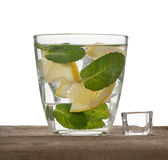 Water, ice, lemon and mint isolated on white background Royalty Free Stock Photos