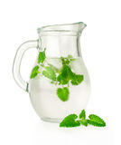 Water with ice and mint in a glass jug Stock Images