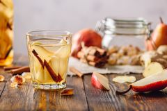 Water Infused with Pear, Cinnamon, Ginger and. Glass of Water Infused with Sliced Pear, Cinnamon Stick, Ginger Root and Some Sugar. Ingredients Scattered on stock image