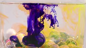 Water and ink mixing for a beautiful abstract. Glass balls with bubbles in the water stock video footage