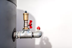 Water installation with tap, pipe connector and safety valve in industrial plumbing Stock Images
