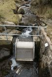 Water intake apparatus. Micro hydro-electric water intake apparatus with filter, pipe and cable sensor Stock Images