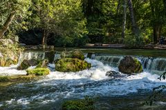 Water of the isar in The English Garden, Munich, Germany stock images