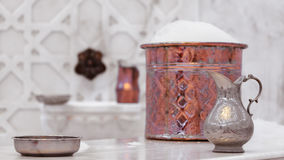 Water jar and copper bowl with soap foam in turkish hamam. Tradi Royalty Free Stock Image