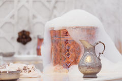 Water jar, towel and copper bowl with soap foam in turkish hamam Stock Photography