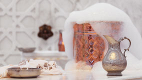 Water jar, towel and copper bowl with soap foam in turkish hamam Stock Photo