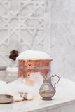 Water jar, towel and copper bowl with soap foam in turkish hamam Stock Images