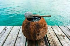 Water jar on wooden floor Stock Image