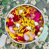 Water with jasmine and roses corolla in bowl Stock Images