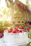 Water with jasmine and roses corolla in bowl for Songkran festival. In Thailand Stock Image