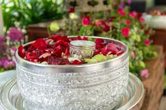 Water with jasmine and roses corolla in bowl for Songkran festival. In Thailand Royalty Free Stock Images