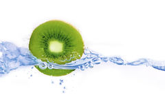 Water jet and kiwi  Stock Images