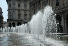 Water jets. The water fountain in Genova - Italy Stock Images