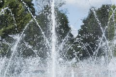 Spray and water jets from the fountain stock image