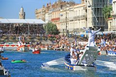 Water Jousting performance in Sète, Languedoc-Roussillon, south of France. SETE, FRANCE -August 27, 2018: Water Jousting performance during St.Louis festival stock image