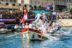 Water Jousting performance during St.Louis festival at the streets of Sete, South of France royalty free stock images