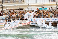 Water jousting in Sete town. SETE, FRANCE - July 30, 2017: Water jousting competition which lasted in Sete on the south of France. Jousting is a fight on the Royalty Free Stock Image