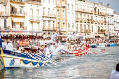 Water jousting in Sete town. SETE, FRANCE - July 30, 2017: Water jousting competition which lasted in Sete on the south of France. Jousting is a fight on the Stock Photography