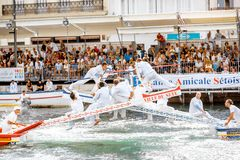 Water jousting in Sete town. SETE, FRANCE - July 30, 2017: Water jousting competition which lasted in Sete on the south of France. Jousting is a fight on the Royalty Free Stock Images