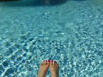 Water joy. Feet toes water blue riffels summer sunny day happy outdors Stock Photo