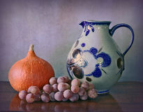 Water jug, pumpkin and grapes Stock Images