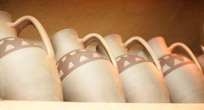 Water jugs. Made from clay and painted staying on a rack Stock Photo