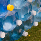 Water Jugs Stack. Angled view of stack of water jugs Stock Photography