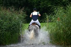 Water jump cross-country Royalty Free Stock Photo