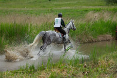 Water jump cross-country. Royalty Free Stock Photography