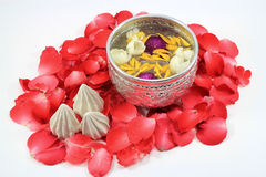Water with jusmine , Songkran festival Thailand. Water with jusmine and roses corolla in bowl and soft-prepared chalk for Songkran festival, Thailand Royalty Free Stock Image