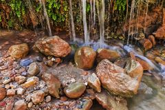 Water kisses stones. Mountain river. Nature and landscapes royalty free stock photography