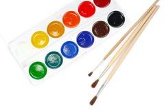 Water-kleur en drie borstels Royalty-vrije Stock Afbeelding