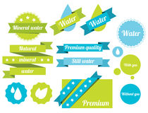 Water labels. Set of water badges, labels and icons. Bitmap illustration with additional vector file in EPS format Stock Photos