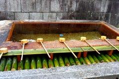 Water Ladles For Purification. Bamboo water ladles for purification at the entrance to Itsukushima Shrine in Miyajima Island in Hokkaido. The water fountain is Royalty Free Stock Image