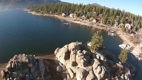 Water Lake Aerial. An illustration of house in the woods surrounded with pine trees stock video footage