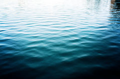 Water lake background with ripples, surface. Sea Royalty Free Stock Photo