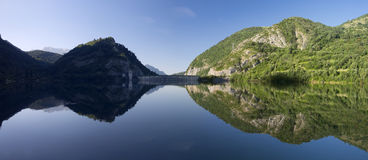 Water, lake and mountain in Tena valley Stock Images