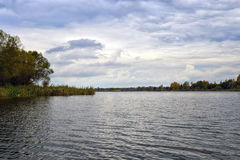 Water landscape with clouds and rippling water. Water landscape with clouds and ripples in the water of the lake royalty free stock images