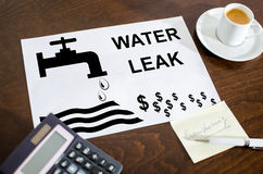 Water leak concept on a paper. Placed on a desk Royalty Free Stock Images