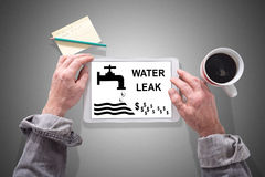 Water leak concept on a tablet Royalty Free Stock Photography