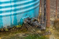 Free Water Leakage From Crack In Water Tank Installed In House Rooftop Royalty Free Stock Images - 161058639