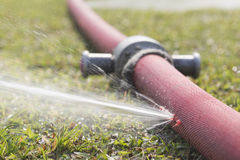 Water leaking from hole in hose Stock Photo